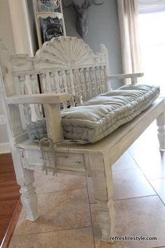 old bed repurposed into a bench looks like an old headboard and