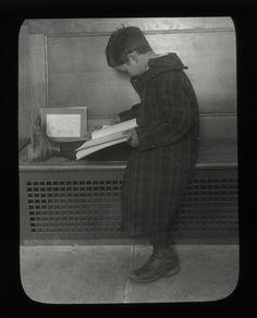 Fordham, boy reading on bench