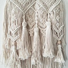 Tassel Macrame wall hanging. This is a handmade Macrame Wall Hanging made with 2mm 100% unbleached cotton rope. Perfect for any macrame lover home, it will add an instant bohemian feeling to any room! Approximate Dimensions: Wooden Dowel: 12 inches Length(from wood to end of