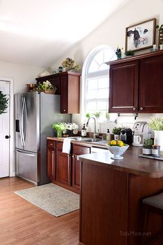 Bright Fresh Creamy White Paint With Dark Cherry Cabinets Helps To Brighten  Up The Kitchen!