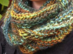 easy cowl scarf? just knit and purl, but it's in the round, so maybe a first project.