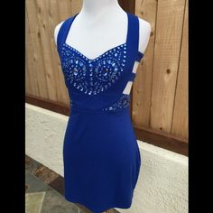 Blue Embellished Cut Out Dress Sleeveless with straps over the shoulder. Embellished with blue rhinestones and glass beads. The zipper is on the back of the dress. Great for a night out on the town. Like new condition. Lovey Dovey Dresses Mini