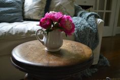 pink peonies on a piano stool