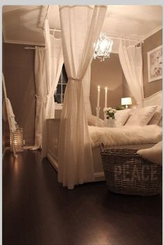 Love the flowing curtains above the bed. Created with curtain rods hanging from the ceiling.