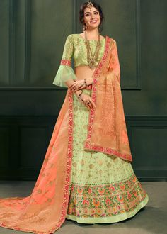 A perfect definition of superb craftsmanship in this refreshing green colored designer Indo Western lehenga choli. The splendid embroidered jacquard work done throughout the top and the frill layered lehenga is bound to make you look more enchanting. Brocade Blouse Designs, Choli Designs, Fancy Blouse Designs, Lehenga Designs, Brocade Lehenga, Green Lehenga, Sari, Saree Blouse, Pakistani Dresses Party