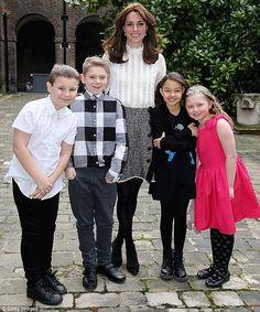 Kate wore a smart £375 Dolce & Gabbana skirt and a £120 high-neck 'Vinnie' shirt by Reiss ...