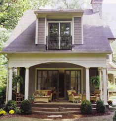 sweet little cottage, porch, brown double french doors with grid pattern