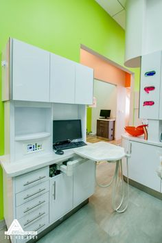 Vibrant Green and Sleek Cabinetry. Dental Office Design by Arminco Inc.