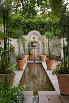 Simple, elegant and classic water feature idea for a courtyard or small garden