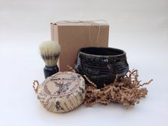 Here is a gift for a hard to shop for man in your life.  It's pretty hip.  Handmade pottery shaving bowl with soap and brush for only $32.00 by JaysClay.