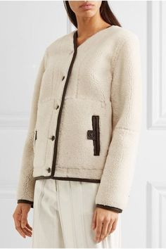 Beige, camel and dark-brown shearling Button fastenings through front 100% shearling (Lamb) Specialist clean Designer color: Cognac