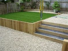 sleeper retaining wall and steps, black concrete, cotswold gravel, turfing lawn, Highworth Swindon Wiltshire