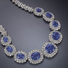 Sapphire and diamond necklace made up of nine cushion and oval-cut sapphires weighing approximately 26.86 to 4.71 carats.