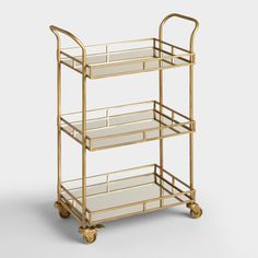 Serve drinks in style with three-tier bar cart featuring mirrored trays and an…