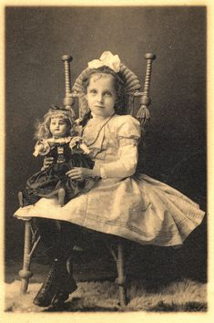 Sweet little girl and her dolly photo. I love the chair.