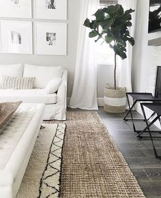 -SummerSunHomeArt.Etsy.Com-Inspiration | Layering a rug under the coffee table adds contrast and a design touch to this white space. Great use of the large basket as a planter.