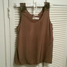 Silk beaded tank top Mocha colored silk tank top. Flowy tank can be dressed up or down. Hand beaded. 100% silk. Dry clean only. Note, tag outline can be seen on the back (see 3rd picture) Tops Tank Tops