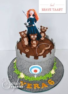 Ellie likes Merida on this cake...she's edible and looks real, the target on the side and the three little bears