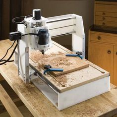 This CNC machine is designed for routing wood, engraving plastics, and even etching or cutting tile