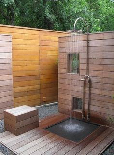 Outdoor shower enclosure with wooden walls Wooden shower enclosures for outdoor living spaces are inexpensive and easy to build. Wooden shower designs are great DIY projects to improve backyards and gardens and add stunning centerpieces that are functional and stylish.