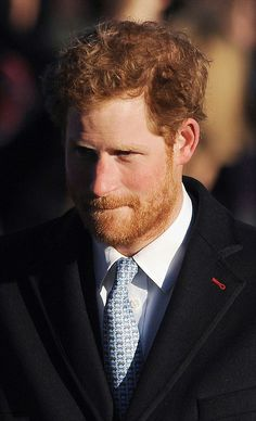 A bearded Prince Harry returned from a trip to Cape Town to join the festivities for  the Christmas Day service at Sandringham 2013