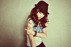 something about that hat and pose is strikingly eye catching.
