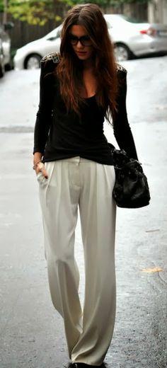 White Silk slacks and Black Shoulder bag.