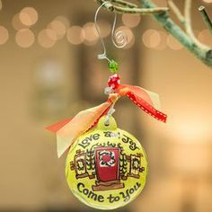 """Ceramic ball ornament with bead and bow accents and a festive motif.  Product: OrnamentConstruction Material: Ceramic, beads, wire and ribbonColor: YellowFeatures: Great addition to any holiday decorDimensions: 4.5"""" DiameterNote:  Additional image depicts back of the ornamentsCleaning and Care: Wipe with clean, dry cloth"""