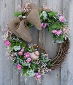 Summer Wreath w/Pink Sweetheart Roses and pale pink and soft lavender Statice, burlap bow and pink bird in it's own grapevine wreath