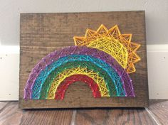 A bright and fun rainbow string art wooden sign home decor nursery decorations from my Etsy shop https://www.etsy.com/listing/281079466/string-art-rainbow-sunshine-here-comes