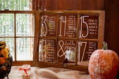 @Sharon of Eden Photography, reclaimed windows for seating assignments, wedding reception decor, table numbers, fall wedding theme