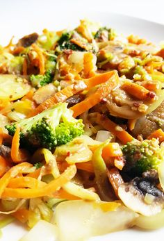 Perfect for a light and simple meal, this stir-fry is filled with chopped and spiralized veggies and drizzled with a bold and flavorful peanut sauce.