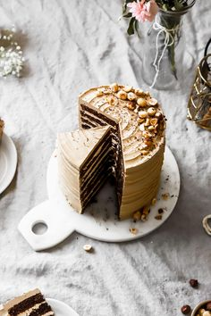 Mocha Cake is made up of eight luscious chocolate cake layers frosted with coffee Swiss meringue buttercream and topped with toasted hazelnuts. Chocolate Mocha Cake, Chocolate Flavors, Layer Cake Recipes, Dessert Recipes, Food Cakes, Cupcake Cakes, Coffee Buttercream, Chocolate Swiss Meringue Buttercream, Buttercream Frosting
