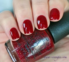 Opi Underneath the mistletoe. Red jelly base loaded with glitter.