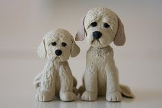 Another cake shop order.  I dunno what breed they are.  From the photos, they look like labradors crossed with poodles.  This time, I used polymer clay as I found I could texture it better (eg. the fur).  I made a pair in modeling fondant too, but gave these to the cake shop :)  My daughter said they look sad, but I was just copying their photo :)