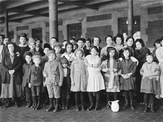 Immigrants of unknown nationality photographed at Ellis Island in New York. Description from blogs.voanews.com. I searched for this on bing.com/images