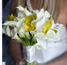 ivory calla lilies and yellow throated green cymbidium orchids...very simple but elegant
