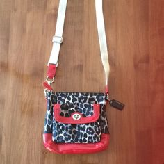 Coach Crossbody NWOT Authentic Leopard/Ocelot Crossbody bag. 8.5x7.5. Adorable pattern. NWOT. Purchased from another posher but never used. I purchased the bag NWT as the 4th picture shows. The inside is grey satin. Coach Bags Crossbody Bags