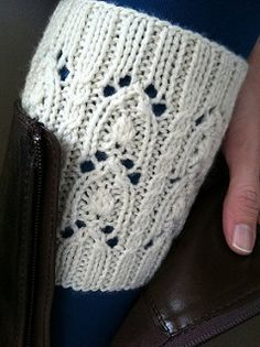 """Keep your legs warm and looking stylish with these boot cuffs. Wear them over skinny jeans, tights, or just bare legs. Darby features a simple little cable, lace stitches, and little extra something from a Japanese stitch dictionary I like to call a """"bud"""" stitch."""