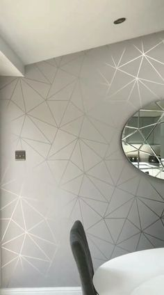 The Zara Shimmer Metallic Wallpaper in Soft Grey & Silver, brought to you by I Love Wallpaper. A Stunning, Superior Geometric Design that enhances Luxury in any Home. For more colourways and similar designs visit ilovewallpaper.co.uk #ilovewallpaper #roomdecor #homeaccessorises #wall #homeaccents #wallpaper