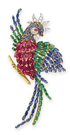 A DIAMOND AND MULTI-GEM PARROT BROOCH  Designed as a parrot, with a marquise-cut ruby body, extending marquise-cut sapphire and emerald wings and tail feathers, the circular-cut sapphire head set with a cabochon ruby eye and single-cut diamond detail, mounted in 18k gold and platinum, with French assay marks