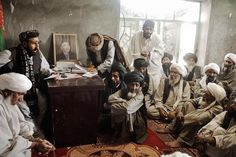 Marja's new district chief meeting with local elders. Marja Helmand Province. Afghanistan. March 2010.  #MoisesSaman/ #MagnumPhotos.  A signed #fineart print by #MoisesSaman from his #Afghanistan series now available in the Magnum Store. Explore more in the Magnum store - link in bio. by magnumphotos