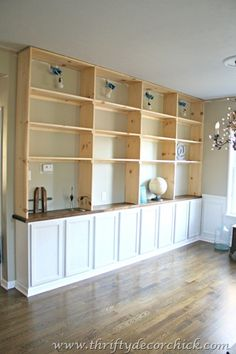 Thriftydecorchic did this herself.  I would build it with reclaimed wood and beadboard cabinets doors.  I would also be better served to have the lower cabinets deeper. This would give me more counter space for my mud/command/craft room.