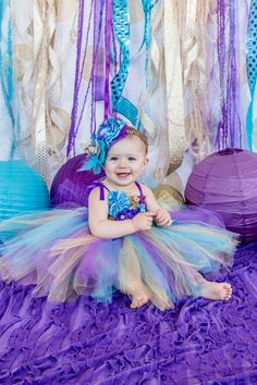 beautiful mermaid under the sea birthday tutu dress for 1st birthday parties or first birthday photo sessions or cake smash sessions. Can also be used for a peacock themed party