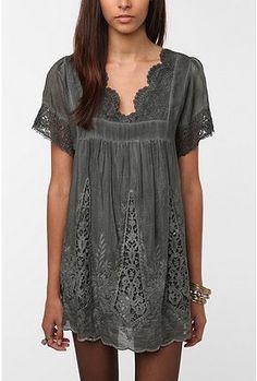 Maybe as a shirt.  It's a little short as a dress.
