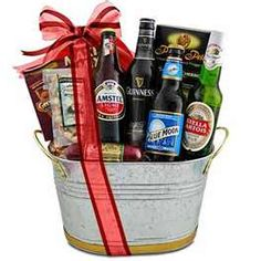 Gift basket idea for a male coworker, groomsmen, boyfriend or husband! Alcohol and snacks.