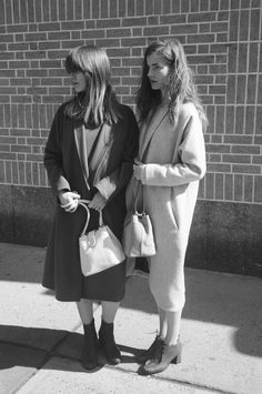 Datura Blog - East Village Girls Andrea wearing our Rust Coat and Dress and Zaga wearing our Ivory Tusk Escape Coat and dress. Picture by Ana Kras