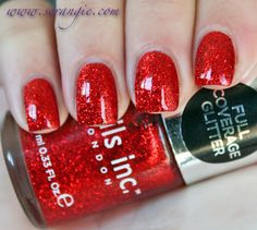 Nails Inc. - Soho Street. A red jelly base with medium-sized chunky red glitter.