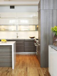 Modern Kitchen - white cabinets up top, wood on bottom, waterfall countertop with seating, poggenpohl cabinetry Kitchen Cabinet Styles, Modern Kitchen Cabinets, Modern Kitchen Design, Kitchen Furniture, Kitchen Interior, Kitchen Decor, Kitchen Contemporary, Contemporary Cabinets, Kitchen Island