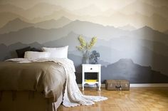 A bedroom gets a one of a kind DIY makeover with a beautiful hand painted mural.